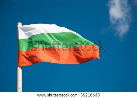 Bulgarian flag against blue sky - stock photo