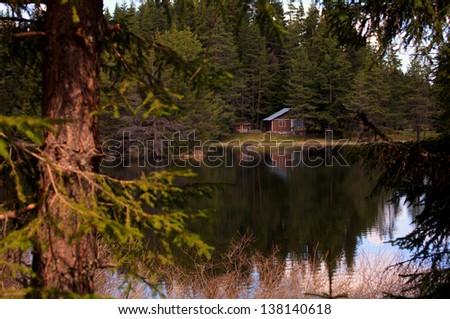 bulgarian forest resort with lake and wooden house
