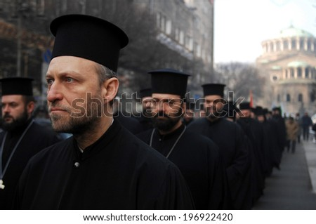 Bulgarian orthodox priest, marching up in front of the church of St. Nedelia in Sofia, Bulgaria - 4, january 2012