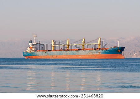 Bulk Carrier Cargo ship anchored off Eilat in Red gulf of Aqaba - stock photo