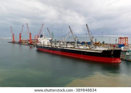 Bulk carrier in port Tamatave-Madagascor - stock photo