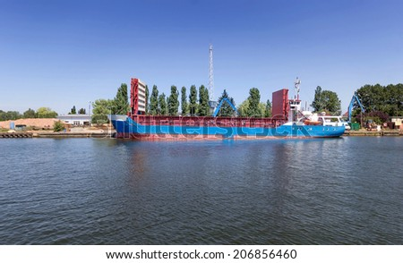 Bulk carrier ship moored at the shipyard of Gdansk, Poland - stock photo