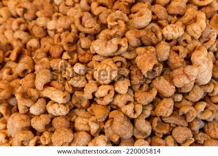 bulk chicharron pieces closeup  - stock photo