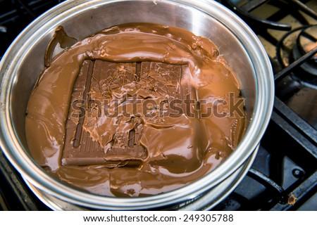Bulk chocolate melting in a pot. - stock photo
