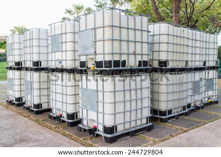 Bulk fluid shipping containers on location ready for shipment - stock photo