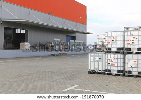 Bulkibox containers for liquid transport behind warehouse - stock photo
