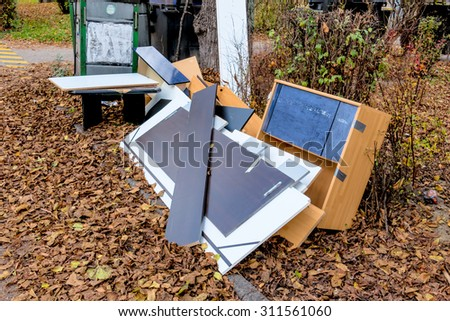 bulky waste on the street, symbol of moving, garbage, throw-away society - stock photo
