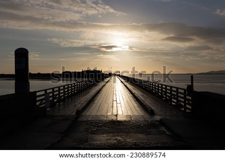 Bull Bridge is a wooden bridge at Dollymount photographed early morning - stock photo
