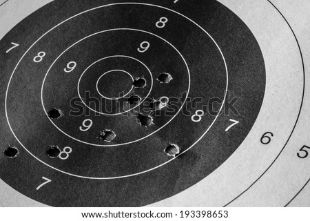 Bull eyetarget with bullet hole