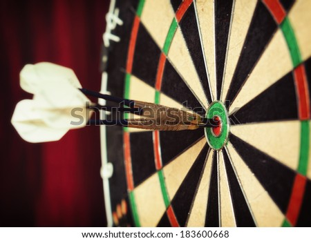 Bull's-Eye ! / Vintage style photo from three darts hit the double Bull's-Eye