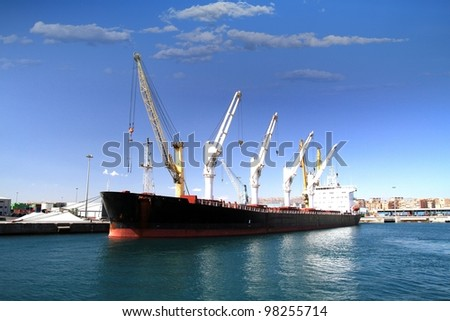 Bullcarrier tied up in the port of Alicante - stock photo