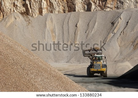 Bulldozer activity in a rock quarry near Split in croatia - stock photo
