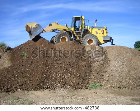 bulldozer in a gravel pit - stock photo