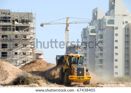 Bulldozer in the city building yard - stock photo