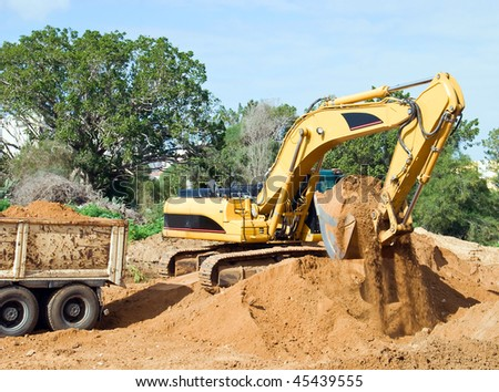 Bulldozer in the road building - stock photo