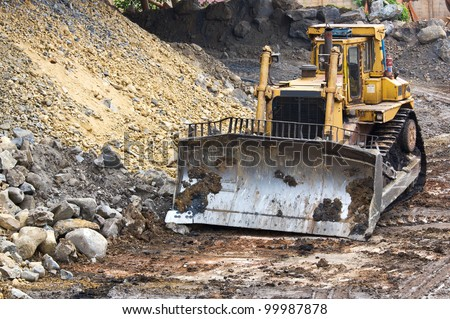 Bulldozer machine doing earth moving work in mining