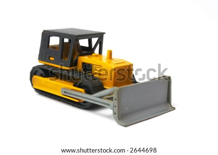 bulldozer of yellow color Isolated on a white background - stock photo