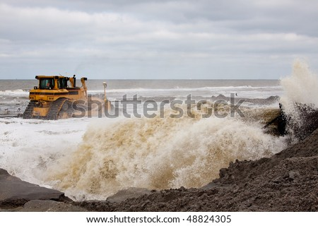 Bulldozer on a land reclamation project - stock photo
