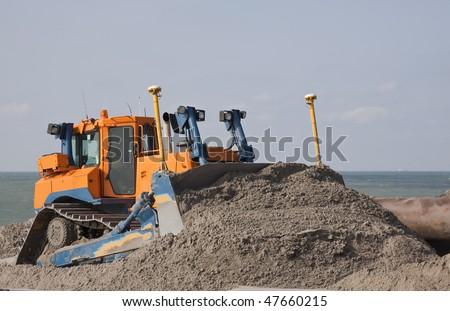 Bulldozer on Maasvlakte 2 project - stock photo