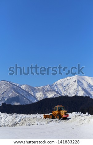Bulldozer removing snow. - stock photo