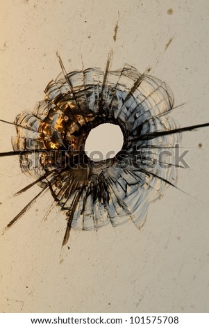 bullet hole in a glass - stock photo