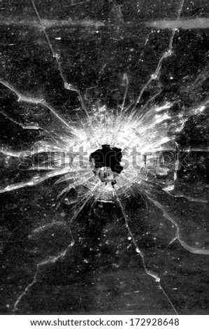 Bullet hole in glass - stock photo