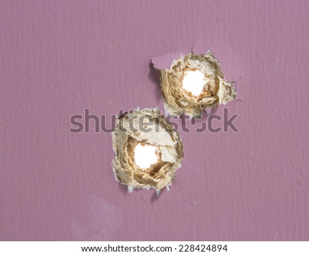 Bullet hole in painted wood - stock photo