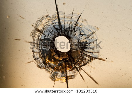bullet hole in window - stock photo