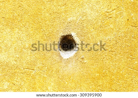 Bullet hole on the wall - stock photo