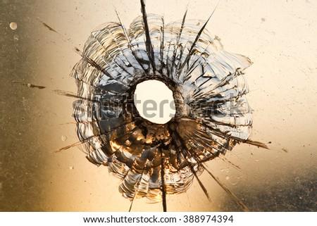 Bullet holeon on the window - stock photo