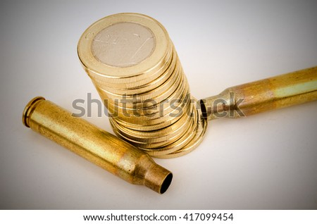Bullet shells and coins,  a financial crime concept