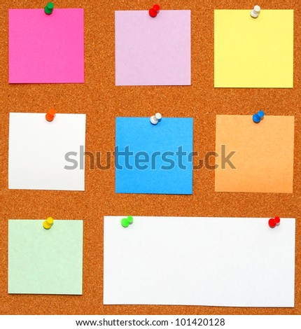 Bulletin board. Color pins with color papers - stock photo