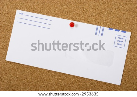 Bulletin board with a blank envelope that you can write your own message on - stock photo