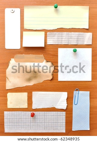 bulletin board with paper notes and old blank - stock photo