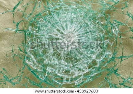 Bulletproof glass after the shooting with traces of bullets, test, close-up - stock photo