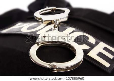 Bulletproof vest and handcuffs - stock photo