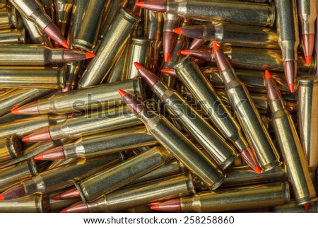 bullets ammunition in a row - stock photo