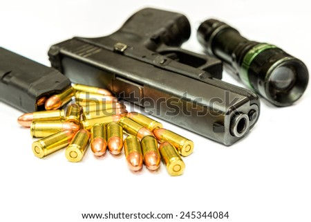 Bullets and Gun on white background with searchlight - stock photo