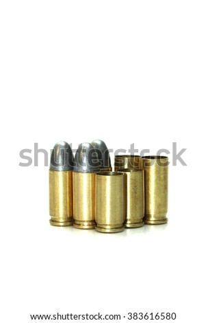 Bullets and shells pistol handgun isolated on white background - stock photo