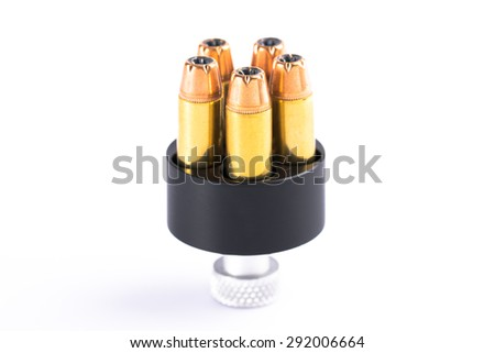 Bullets and speed loader on white background - stock photo