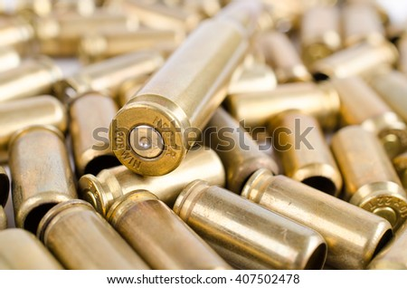 Bullets, casings from bullets on white background - stock photo