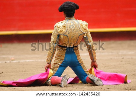 Bullfighter in the ring - stock photo