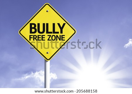 Bully Free Zone road sign with sun background - stock photo