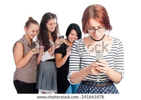 Bullying girls using smartphones - stock photo