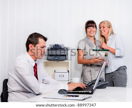 bullying in the workplace an office. women are talking about colleagues - stock photo