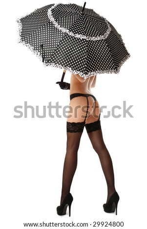 Bum and legs of sexy slim tanned girl in stockings and stilettos hiding under umbrella, over white background - stock photo