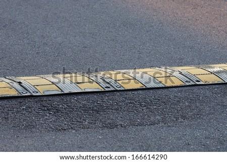 Bumps on the asphalt - stock photo