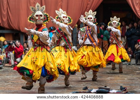 Bumthamg, Bhutan, 05 Nov 2011: Dancers  in colourful costumes performing at Jakar Festival. - stock photo