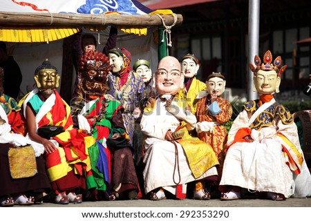 BUMTHANG, BHUTAN - OCTOBER 6, 2011: Buddhist perform in traditional costumes with terrifying masks during religious Tsechu festival in Bhutan. Tsechu are annual religious Bhutanese festivals. - stock photo
