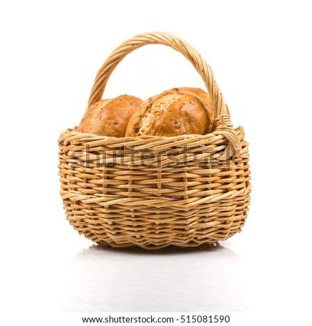 Bun bread in wicker basket isolated on white background